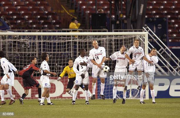 Tenywa Bonseu Richard Farrer Steve Morrow Jason Kreis and Chad Deering of the Dallas Burn form a wall to defend the goal against a free kick by the...