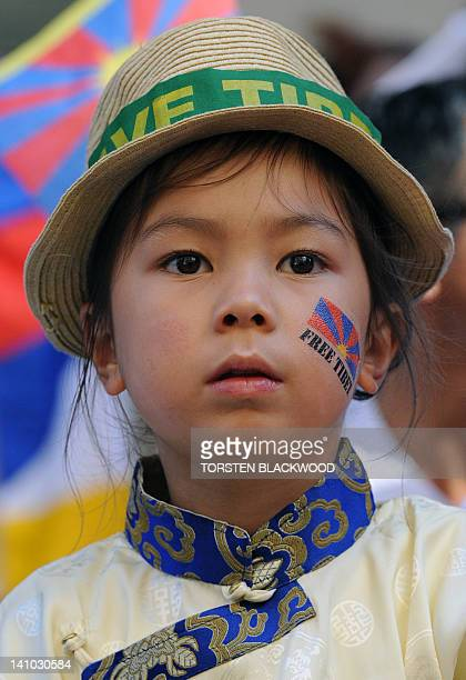 Tenzin age six listens to speeches marking the 53rd anniversary of the Tibetan uprising in Sydney on March 10 2012 Over 150 members of Australia's...