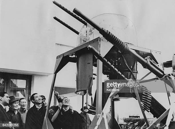 Tenzin Gyatso the 14th Dalai Lama and Choekyi Gyaltsen the 10th Panchen Lama watch a demonstration of antiaircraft guns during a tour of the Indian...