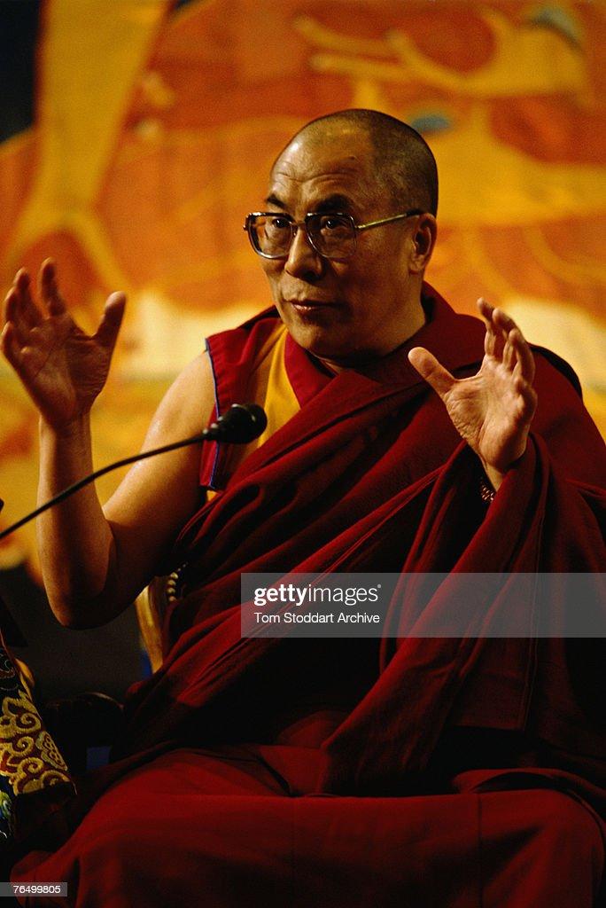 Tenzin Gyatso, the 14th Dalai Lama, during a visit to Britain, 6th April 1988.