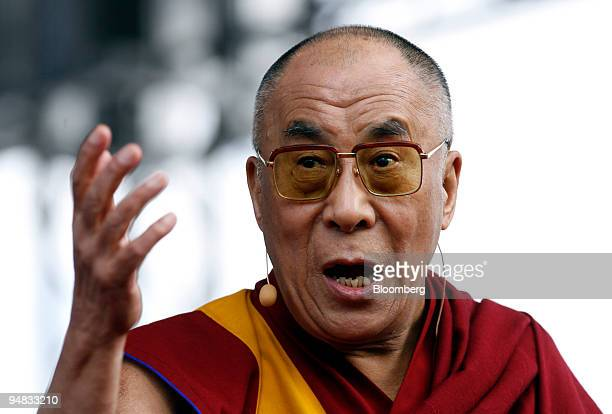 Tenzin Gyatso, the 14th Dalai Lama, gestures while speaking in Berlin, Germany, on Monday, May 19, 2008. German Development Minister Heidemarie...