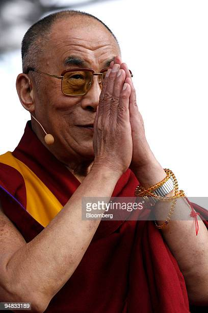 Tenzin Gyatso, the 14th Dalai Lama, greets his audience in Berlin, Germany, on Monday, May 19, 2008. German Development Minister Heidemarie...