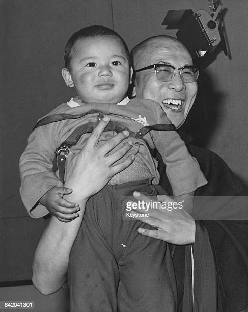 Tenzin Gyatso the 14th Dalai Lama with a young Tibetan child who greeted him at the airport upon his arrival in London UK 22nd October 1973