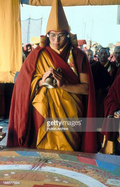 Tenzin Thuthob Tsarong performs a ritual in a scene from the film 'Kundun' 1997
