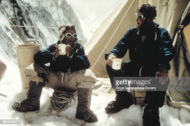 Tenzing Norgay and Edmund Hillary drink tea in the Western Cwm Tenzing Norgay and Edmund Hillary drink a celebratory cup of tea at Camp IV in the...