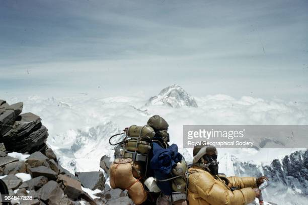 Tenzing Norgay and Edmund Hillary resting on the South East ridge of Everest at approximately 27000 feet Nepal 28th May 1953 Mount Everest Expedition...