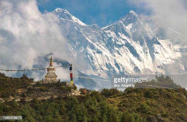 tenzing norgay memorial stupa with beautiful view of mt.everest and mt.lhotse in behind. - stupa stock pictures, royalty-free photos & images