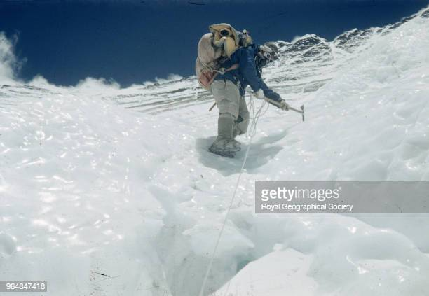 Tenzing Norgay wearing crampons climbing down an icy patch on the Lhotse Face Nepal March 1953 Mount Everest Expedition 1953