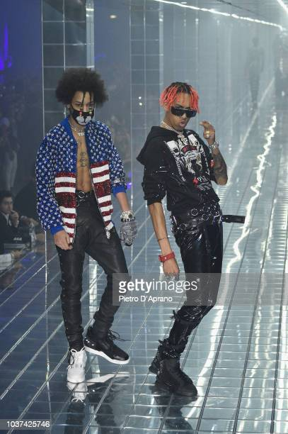 Teo and Ayo walk the runway at the Philipp Plein show during Milan Fashion Week Spring/Summer 2019 on September 21 2018 in Milan Italy