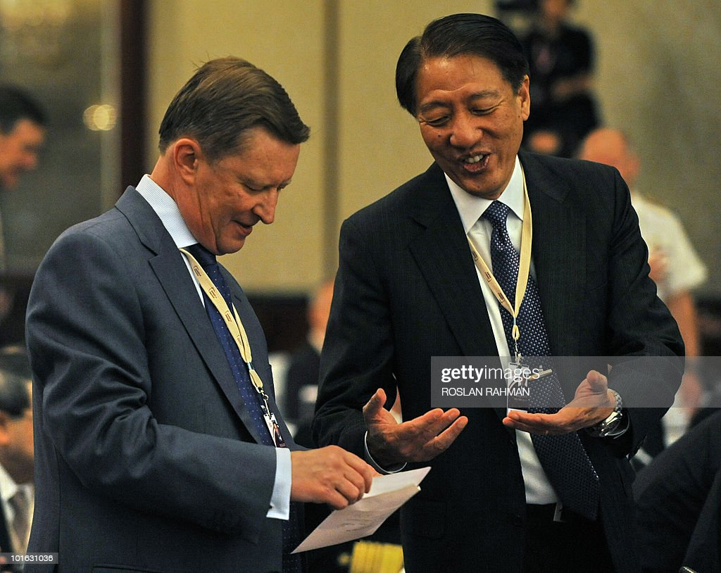 Teo Chee Hean (R), Singapore Deputy Prime Minister and Defence Minister chats with Russian Deputy Prime Minister Sergei Ivanov (L) at the Asia-Pacific security forum in Singapore on June 5, 2010. The United States is weighing fresh steps to hold North Korea to account after the sinking of a South Korean warship, US Defense Secretary Robert Gates said .