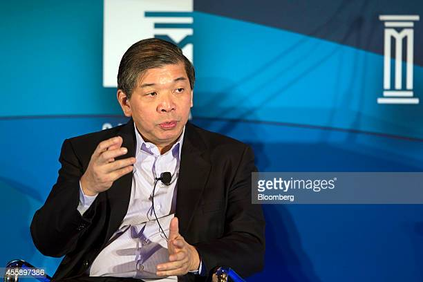 Teo Siong Seng chief executive officer of Singamas Container Holdings Ltd gestures as he speaks at the Milken Institute Asia Summit in Singapore on...