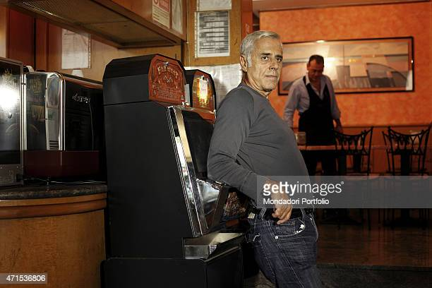 'Teo Teocoli famous Italian anchorman and imitator leans on a slot machine in the coffee bar Vega in Piazza Istria the actor has become famous in the...