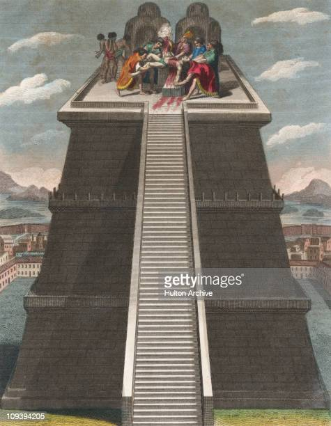 A teocalli or Mesoamerican temple pyramid in Mexico with a priest offering human sacrifice on the top circa 1500 An engraving by J Chapman for the...