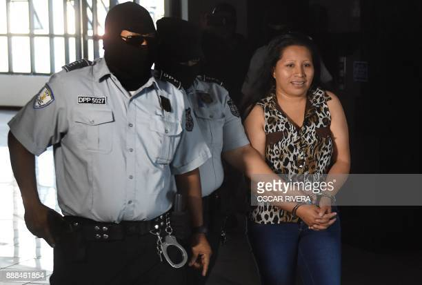 Teodora del Carmen Vasquez is escorted as she arrives at the Isidro Menendez Judicial Center to attend a hearing to review her 2008 sentence handed...