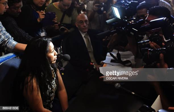 Teodora del Carmen Vasquez is hounded by the press at the Isidro Menendez Judicial Center during a hearing to review her 2008 sentence handed down...