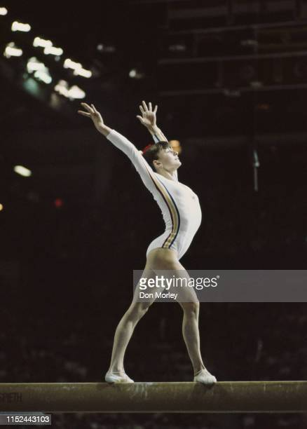 Teodora Ungureanu of Romania performs her routine on the Balance Beam during the Women's Artistic Team allaround event on 19 July 1976 during the XXI...