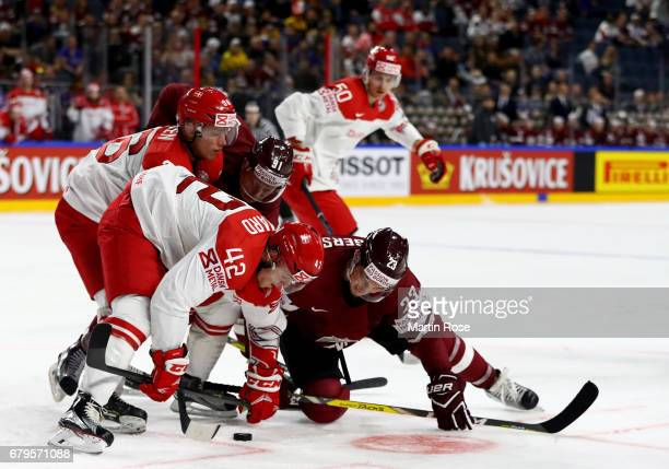 Teodors Blugers of Latvia challenges Mikkel Aagaars of Denmark for the puck during the 2017 IIHF Ice Hockey World Championship game between Latvia...