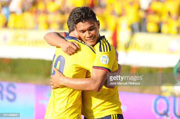 Teofilo Gutierrez and James Rodriguez of Colombia celebrate a goal during a match between Colombia and Uruguay as part of the South American...