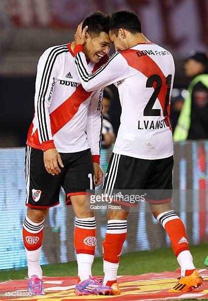 Teofilo Gutierrez and Leonel Vangioni of River Plate celebrate after scoring the third goal of his team during a match between River Plate and...