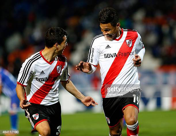 Teofilo Gutierrez celebrates with teammate Tomas Martinez after scoring the fourth goal of his team during a match between Godoy Cruz and River Plate...