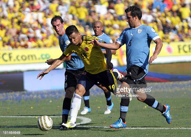 Teofilo Gutierrez of Colombia and Mauricio Victorino of Uruguay fight for the ball during a match between Colombia and Uruguay as part of the South...