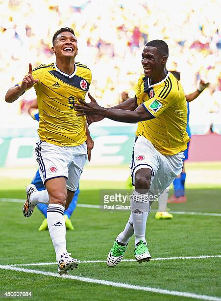 Teofilo Gutierrez of Colombia celebrates scoring his team's second goal with Cristian Zapata during the 2014 FIFA World Cup Brazil Group C match...