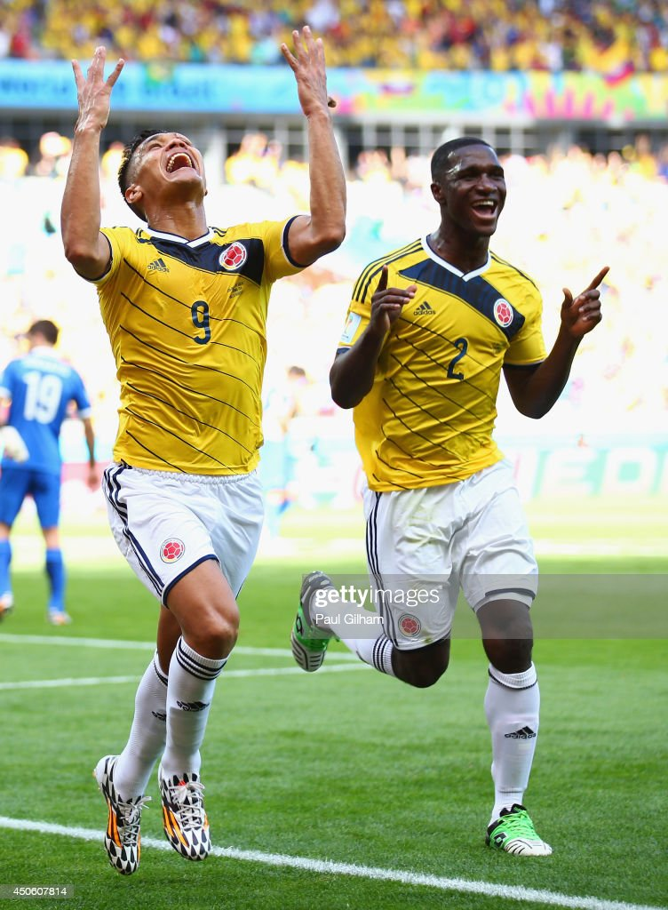 Teofilo Gutierrez of Colombia (L) celebrates scoring his team's second goal with Cristian Zapata during the 2014 FIFA World Cup Brazil Group C match between Colombia and Greece at Estadio Mineirao on June 14, 2014 in Belo Horizonte, Brazil.