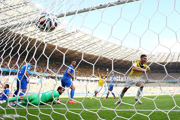 Teofilo Gutierrez of Colombia celebrates scoring his team's second goal against goalkeeper Orestis Karnezis of Greece during the 2014 FIFA World Cup...