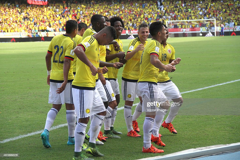 Teofilo Gutierrez of Colombia celebrates with teammates after scoring the opening goal during a match between Colombia and Peru as part of FIFA 2018 World Cup Qualifier at Metropolitano Roberto Melendez Stadium on October 08, 2015 in Barranquilla, Colombia.
