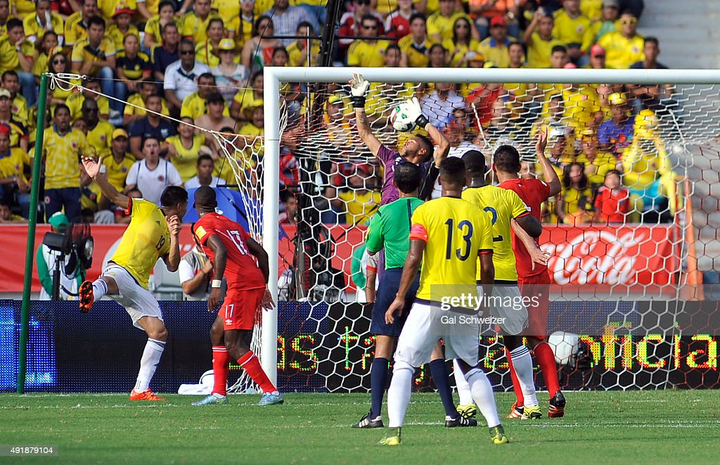 Teofilo Gutierrez of Colombia heads the ball to score the opening goal during a match between Colombia and Peru as part of FIFA 2018 World Cup Qualifier at Metropolitano Roberto Melendez Stadium on October 08, 2015 in Barranquilla, Colombia.