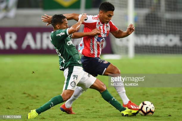 Teofilo Gutierrez of Colombia's Junior, vies for the ball with Gustavo Scarpa of Brazil's Palmeiras, during their 2019 Copa Libertadores football...