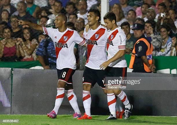 Teofilo Gutierrez of River Plate and teammates celebrate their team's third goal during a match between Sarmiento and River Plate as part of first...
