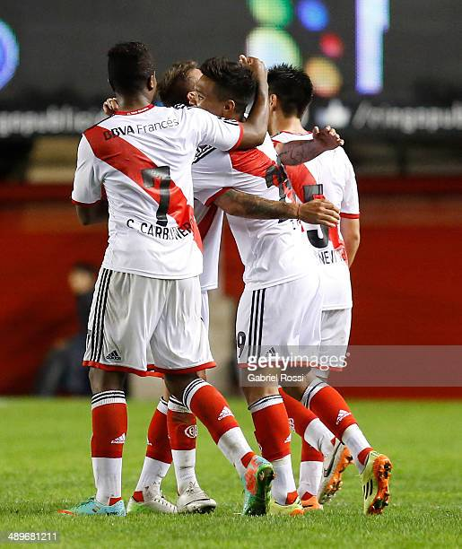 Teofilo Gutierrez of River Plate and teammates celebrate their team's second goal during a match between Argentinos Juniors and River Plate as part...