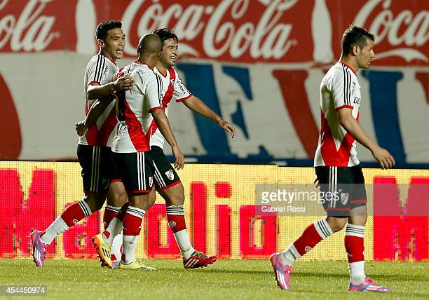 Teofilo Gutierrez of River Plate celebrates with his teammates after scoring the second goal of his team during a match between San Lorenzo and River...