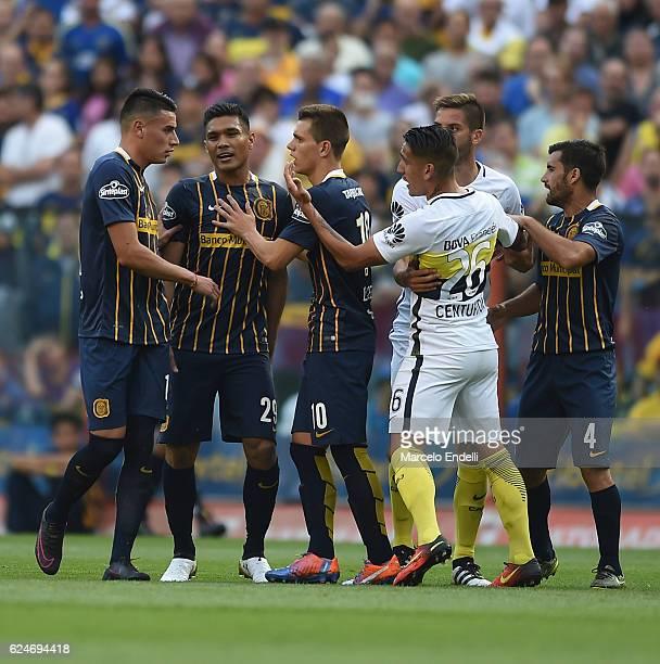 Teofilo Gutierrez of Rosario Central argues with Ricardo Centurion of Boca Juniors during a match between Boca Juniors and Rosario Central as part of...