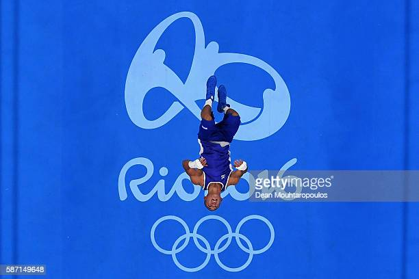 Teofimo Andres Lopez Rivera of Honduras does a flip after his fight with Sofiane Oumiha of France in the Men's Light 60kg preliminary bout on Day 2...