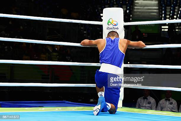 Teofimo Andres Lopez Rivera of Honduras prays after his fight with Sofiane Oumiha of France in the Men's Light 60kg preliminary bout on Day 2 of the...
