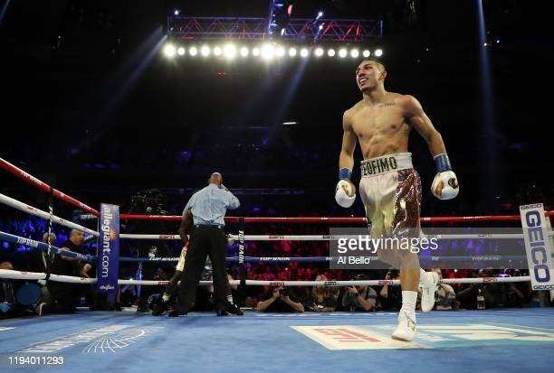 Teofimo Lopez Jr celebrates after his TKO second round knockout against Richard Commey during their bout for Commey's IBF lightweight title at...