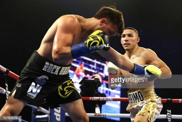 Teofimo Lopez knocks out Mason Menard in the first round during their lightweight fight at The Hulu Theater at Madison Square Garden on December 08...