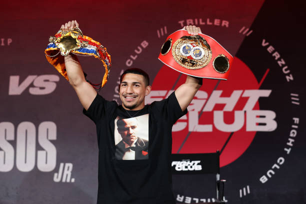 Teofimo Lopez poses with his championship belts during a press conference for Triller Fight Club at Mercedes-Benz Stadium on April 16, 2021 in...