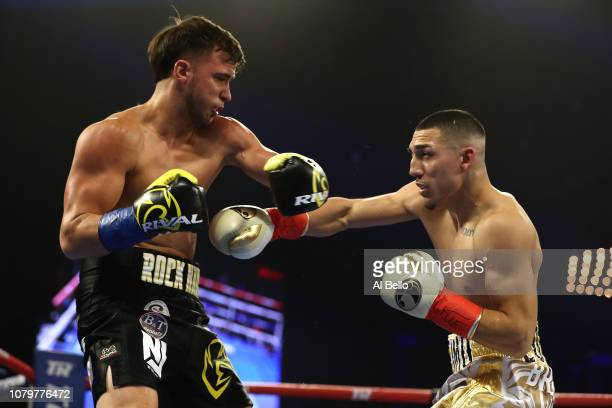 Teofimo Lopez punches Mason Menard in the first round during their lightweight fight at The Hulu Theater at Madison Square Garden on December 08 2018...