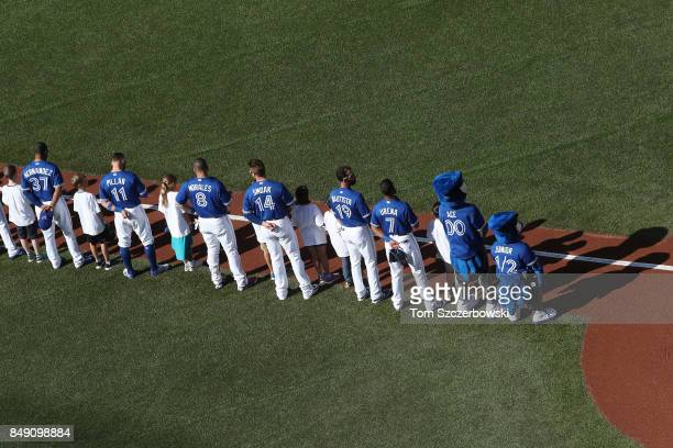 Teoscar Hernandez of the Toronto Blue Jays and Kevin Pillar and Kendrys Morales and Justin Smoak and Jose Bautista and Richard Urena and mascot Ace...