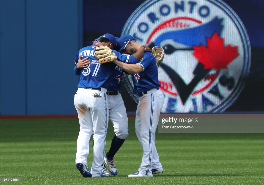 Teoscar Hernandez #37 of the Toronto Blue Jays and Randal Grichuk #15 and Kevin Pillar #11 celebrate their sweep during MLB game action against the Baltimore Orioles at Rogers Centre on June 10, 2018 in Toronto, Canada.