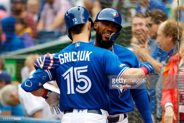 Teoscar Hernandez of the Toronto Blue Jays celebrates a solo home run with Randal Grichuk during first inning of their MLB game against the Tampa Bay...