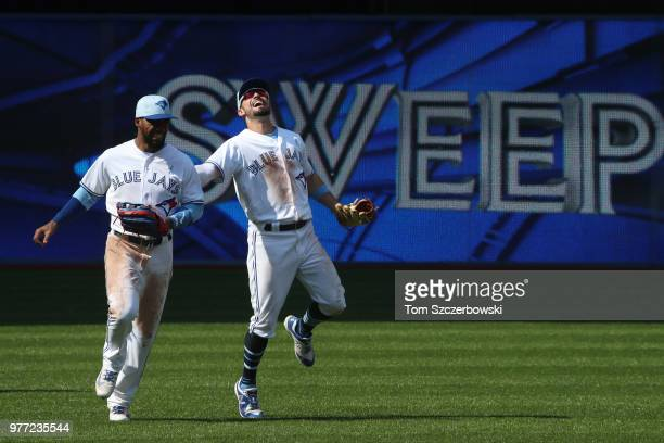 Teoscar Hernandez of the Toronto Blue Jays celebrates a victory with Randal Grichuk over the Washington Nationals at Rogers Centre on June 17 2018 in...