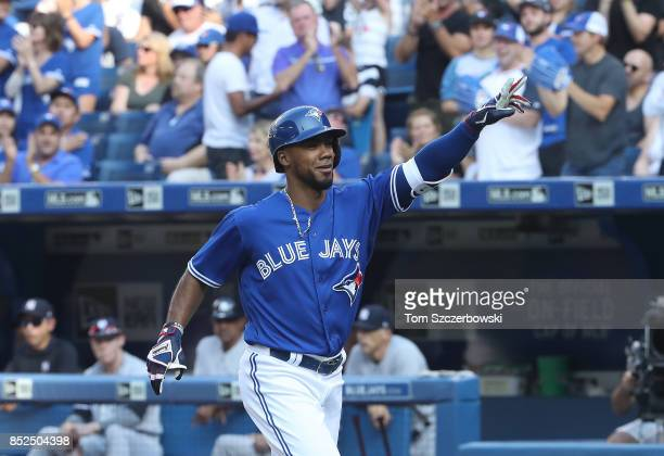 Teoscar Hernandez of the Toronto Blue Jays celebrates after hitting a solo home run in the third inning during MLB game action against the New York...