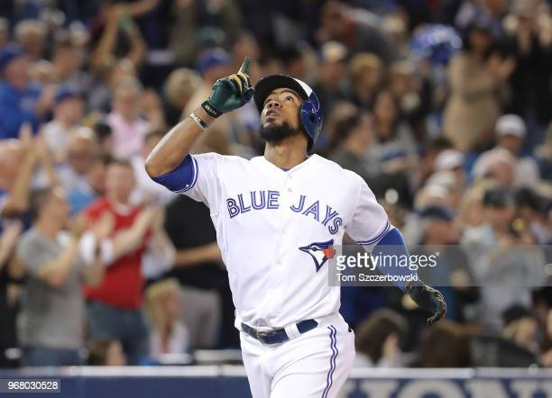 Teoscar Hernandez of the Toronto Blue Jays celebrates after hitting a solo home run in the sixth inning during MLB game action against the New York...