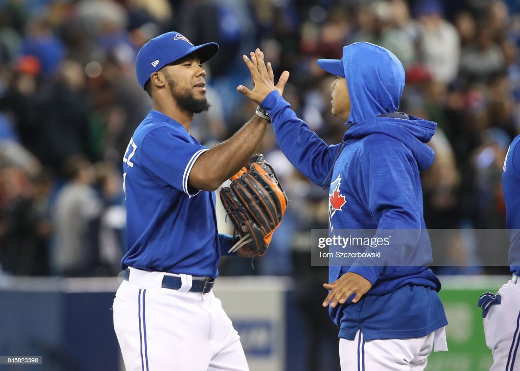 Teoscar Hernandez #36 of the Toronto Blue Jays celebrates their victory with Marcus Stroman #6 during MLB game action against the Baltimore Orioles at Rogers Centre on September 11, 2017 in Toronto, Canada.