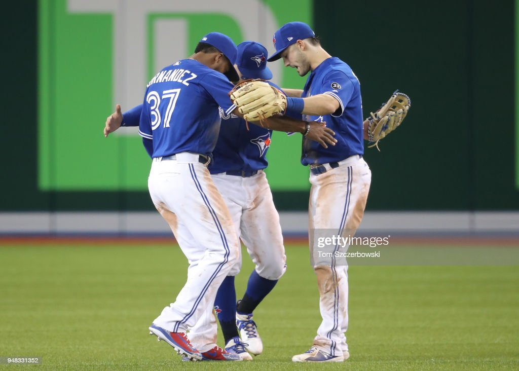 Teoscar Hernandez #37 of the Toronto Blue Jays celebrates their victory with Kevin Pillar #11 and Randal Grichuk #15 during MLB game action against the Kansas City Royals at Rogers Centre on April 18, 2018 in Toronto, Canada.
