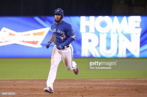 Teoscar Hernandez of the Toronto Blue Jays circles the bases after hitting a tworun home run in the third inning during MLB game action against the...